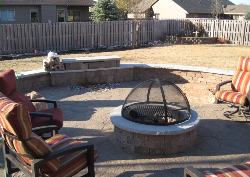 built in fire pit with courtyard walls and water feature